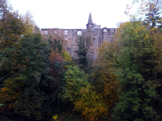 Dunfermline Palace (from Pittencrieff Glen) and Abbey consists of the now ruinous royal palace and domestic buildings of the adjacent abbey, as well as the impressive church nave, in the heritage quarter of the burgh of Dunfermline in Fife.