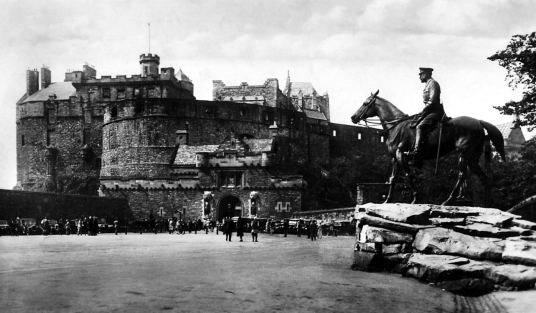 Edinburgh Castle from the esplanade, standing on a rock in the middle of Scotland's capital city, a magnificent fortress and palace, used by the monarchs of Scotland (such as St Margaret and Mary Queen of Scots) as one of the principal strongholds of the