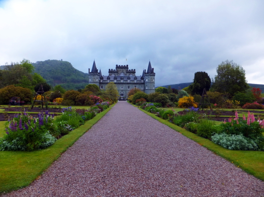 Inverary Castle, a magnificent towered mansion, the seat of the Campbell Dukes of Argyll and located among colourful gardens in a beautiful spot by Loch Fyne near the attractive burgh of Inveraray in Arygll.