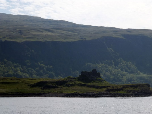 Ardtornish Castle, a shattered old medieval stronghold of the MacDonald Lords of the Isles, in a beautiful spot on the north bank of the Sound of Mull near Lochaline in the Highlands of Scotland.