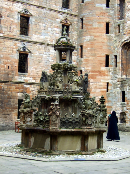 Linlithgow Palace, a large, ruinous and impressive royal residence of the monarchs of Scotland and birthplace of Mary, Queen of Scots, in a scenic location in a park with a pond in the historic burgh of Linlithgow.