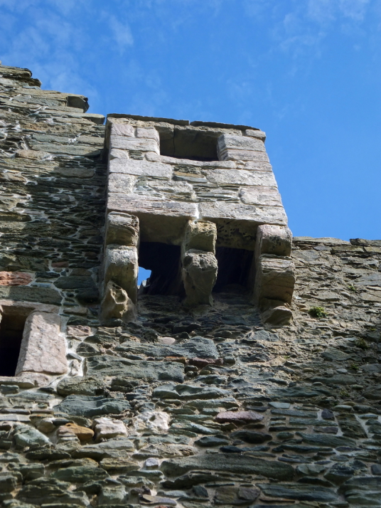 Machiocolated projection, Lochranza Castle, an imposing old ruinous fortress, standing on a spit of land in a stunningly beautiful spot at Lochranza to the north of the mountainous island of Arran on the west coast of Scotland.