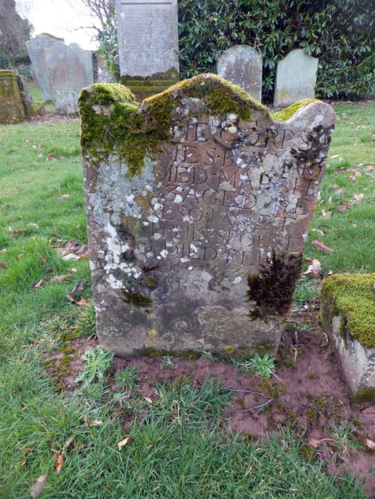 Carved tombstone in graveyard of Foulden Parish Church: Foulden is a pretty village in Berwickshire in southeast Scotland, with the interesting 'tithe' barn, parish church and graveyard with old carved tombstones and the nearby site of Foulden Bastle, the