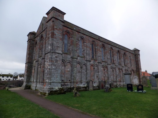 Coldingham Priory was a rich monastic establishment but all the survives is the impressive choir of the former priory standing in a scenic location in the interesting graveyard with many old memorials in the picturesque village of Coldingham in Berwickshi