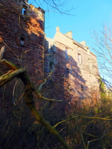 Roslin Castle, an impressive, partly ruinous old stronghold on a rock above the River Esk, long held by the Sinlcairs and near the beautiful and intricately carved Rosslyn Chapel