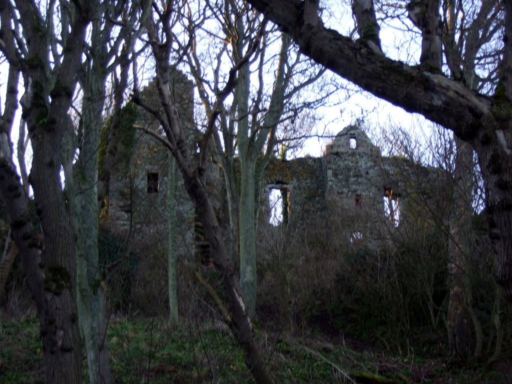 Auldhame, a very ruinous but scenic old building, in a beautiful wooded spot above the beautiful beach of Seacliff, hart Tantallon and some miles from North Berwick in East Lothian in southeast Scotland.