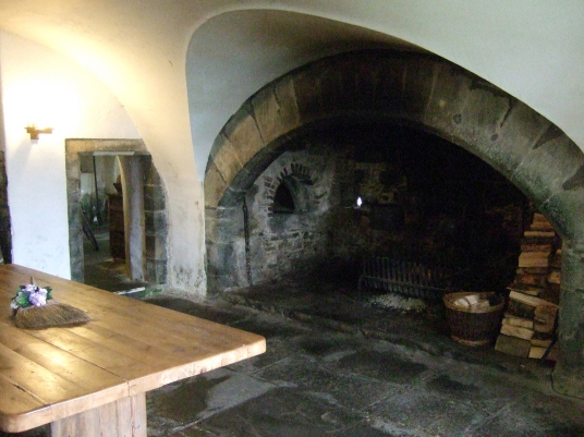 Kitchen, Castle Menzies, a large and imposing old tower house in a picturesque mountainous location, long held by the Menzies clan and with many period rooms to explore, near Aberfeldy in Perthshire in the Highlands of Scotland.