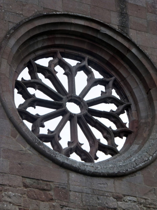 Rose window, Dryburgh Abbey is a fantastic and scenic ruinous abbey, burial place of Walter Scott and set in a peaceful spot by the River Tweed, near Melrose in the Borders in the southeast of Scotland.