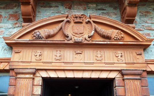 Carving over main entrance, Thirlestane Castle, a fabulous old castle and mansion with many sumptuous chambers, long held by the powerful Maitlands of Lauderdale, and in lovely gardens and grounds near Lauder in the Borders in southern Scotland.