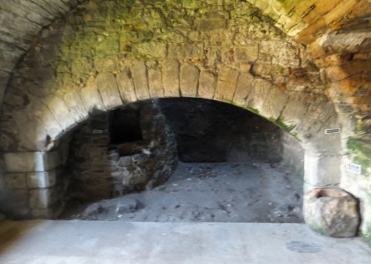 Kitchen fireplace, Aberdour Castle, a scenic old stronghold castle with gardens and orchard of the Douglas Earls of Morton, in the pretty village of Aberdour in Fife.