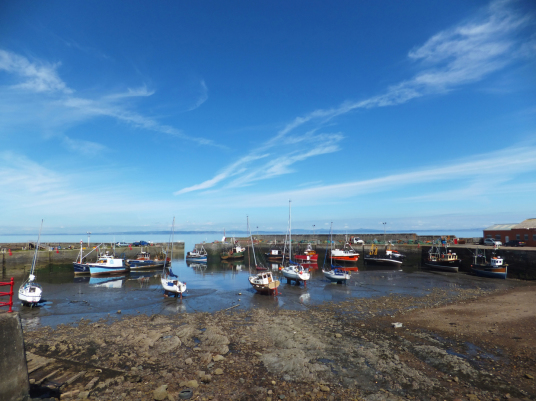 Port Seton harbour, near Seton Castle, a large and impressive Adam mansion near the atmospheric Seton Collegiate Church built by the Seton family, near Tranent and Cockenzie and Port Seton in East Lothian.