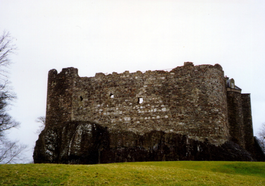 Dunstaffnage Castle, an impressive but grim old ruinous walled castle, long held by the Campbells, with later tower and atmospheric chapel in a wooded spot near Oban in Argyll.