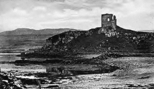 Aros Castle, a shattered and crumbling ruinous old stronghold on a promontory into the Sound of Mull, once held by the MacDonalds and then by the Macleans of Duart, at Aros on the island of Mull in the Hebrides in the western seaboard of Scotland.