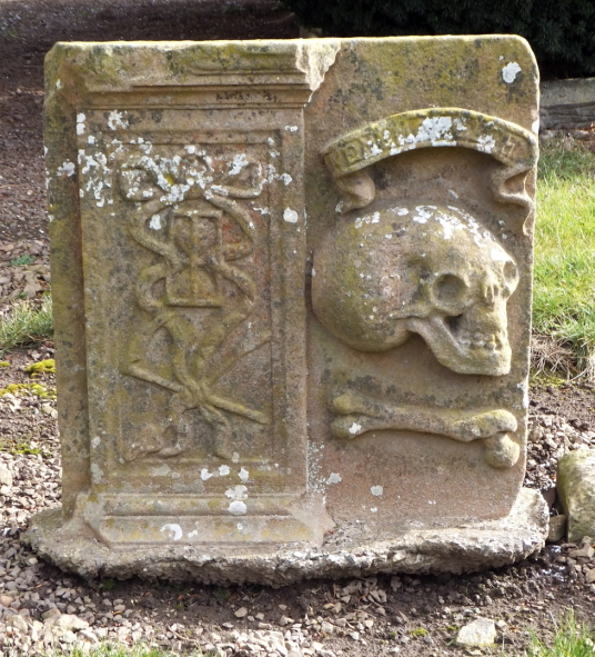 Gravestone at church, Athelstaneford is a pretty village in a scenic spot, site of an old castle of the Hepburns, with an attractive church and doocot, now home to a presentation about the saltire, the flag of Scotland, some miles from Haddington in East