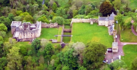 Aerial view, Craignethan Castle, a substantial artillery castle built the influential Hamilton family, now ruinous but with an impressive tower, fortifications and a ditch with a unique caponier, standing in a pleasant wooded location, near Lanark in