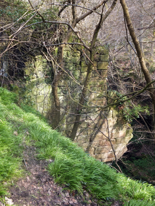 Remains of bridge by Roslin Castle, an impressive, partly ruinous old stronghold on a rock above the River Esk, long held by the Sinlcairs and near the beautiful and intricately carved Rosslyn Chapel
