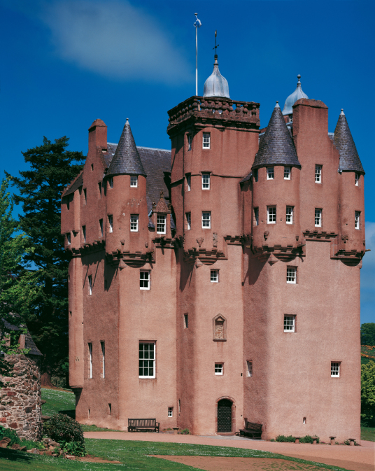 Craigievar Castle by Tom Wolf, a magnificent and imposing old tower house with a fantastic atmospheric and period interior, long held by the powerful Forbes family and set in beautiful wooded grounds in the rolling hills of Aberdeenshire near Alford in no