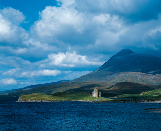 Ardvreck Castle by Tom Wolf, a ruinous old stronghold of the MacLeods of Assynt, in a beautiful spot on the banks of Loch Assynt with the ruin of Calda House, a later house of the Mackenzies, nearby, near Inchnadamph, in Sutherland in the north of Scotlan