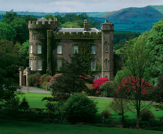 Cloncaird Castle is an impressive mansion incorporating and old tower, held by the Mures, the Kennedys, Mackies and Wallaces, set in fine grounds near Maybole in Ayrshire in southwest Scotland.