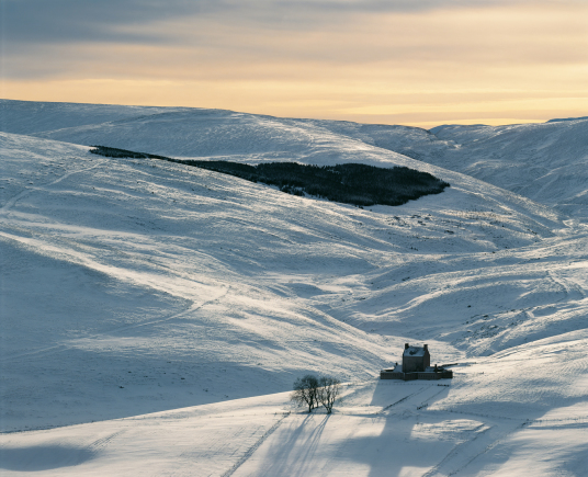 Corgarff Castle by Tom Wolf is an impressive old tower house, with later gun emplacements, held by the Forbeses and site of a famous massacre, in a impressive and mountainous location, some miles from Ballater in the Highlands of Scotland.