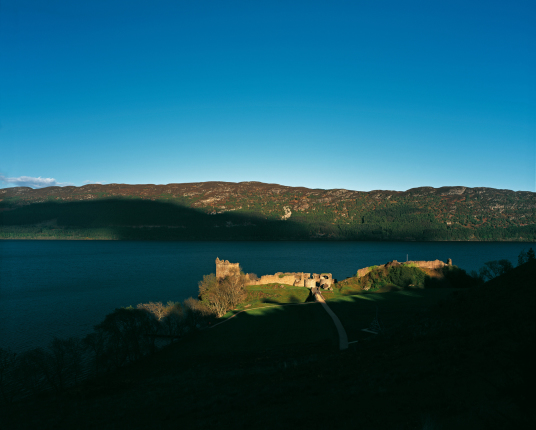 Urquhart Castle by Tom Wolf, a scenic old ruinous stronghold in a beautiful location on the banks of the famous Loch Ness, home to the legendary Loch Ness Monster, near Inverness in the Highlands in the north of Scotland.