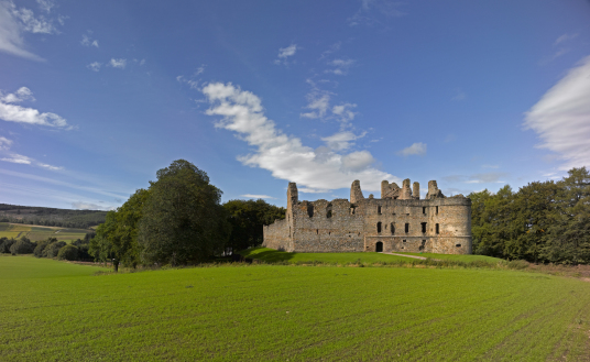 Balvenie Castle by Tom Wolf is a large ruinous courtyard castle with ranges of buildings enclosed by a strong curtain wall and ditch, in a pleasant and peaceful spot near Dufftown in Moray in northern Scotland.