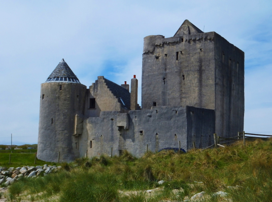 Breachacha Castle, a scenic old restored castle near the later mansion, of the MacLeans of Coll, by a beautiful sandy beach on the coats of the lovely and peaceful Hebridean island of Coll.