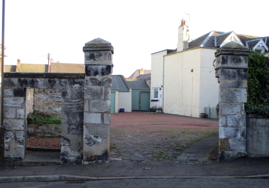 Gateway, Harlawhill House, an old and derelict house, once held by the Hamiltons and then by the Fowlers, in Prestonpans in East Lothian in southeast Scotland.