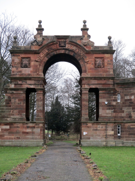 West gate, Gosford House, the large and magnificent mansion of the Earls of Wemyss, set in fantastic landscaped grounds with pleasure grounds, woodland and ponds, standing near Longniddry in East Lothian in southeast Scotland on the banks of the Firth of