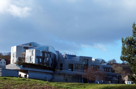 Scottish Parliament Building, Palace of Holyroodhouse, a sumptuous royal residence, scene of the notorious murder of David Rizzio, secretary to Mary Queen of Scots, and still used by the present monarch Queen Elizabeth, at the foot of the famous Royal Mil