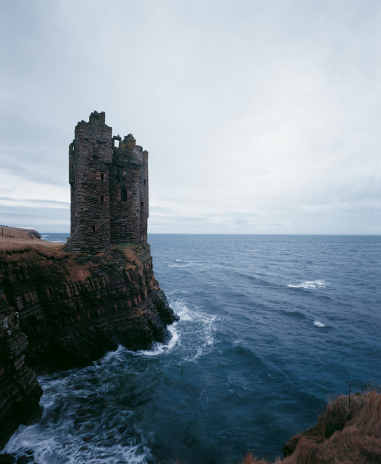 Keiss Castle, an very impressive but crumbling old tower house perched on cliffs above the sea, built by the Sinclairs and some miles from Wick in Caithness in the far north of Scotland.