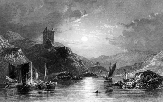 Tarbert Castle, a ruinous but picturesque old royal castle above the pretty village of Tarbert and East Loch Tarbert in Knapdale / Kintyre in Argyll.