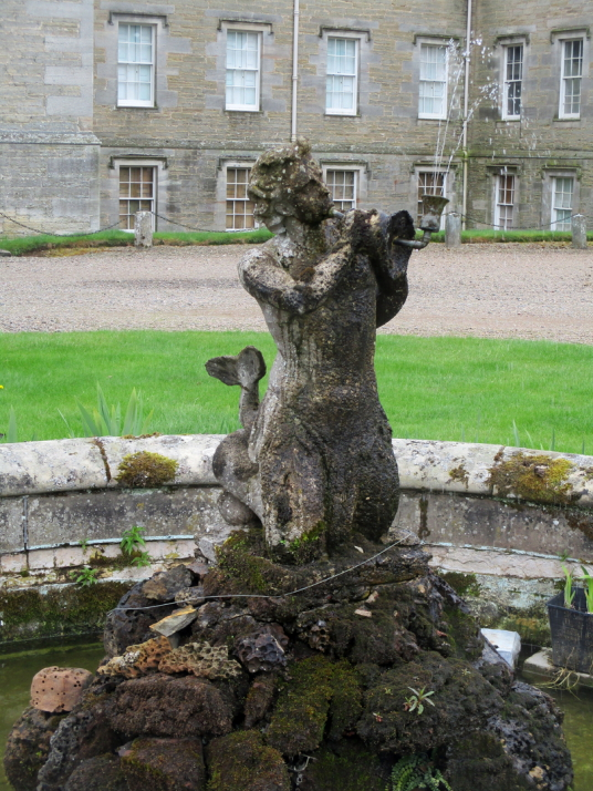 Fountain statue, Mellerstain House, a fine castellated Adam mansion with a stunning and largely original Adam interior, set in beautiful gardens and expansive landscaped grounds.